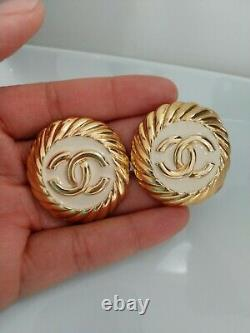 Rare CHANEL Gold Plated And Off White Enamel CC Logos Vintage Clip Earrings